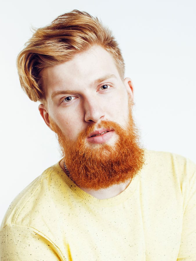 Side swept hair and red bearded man