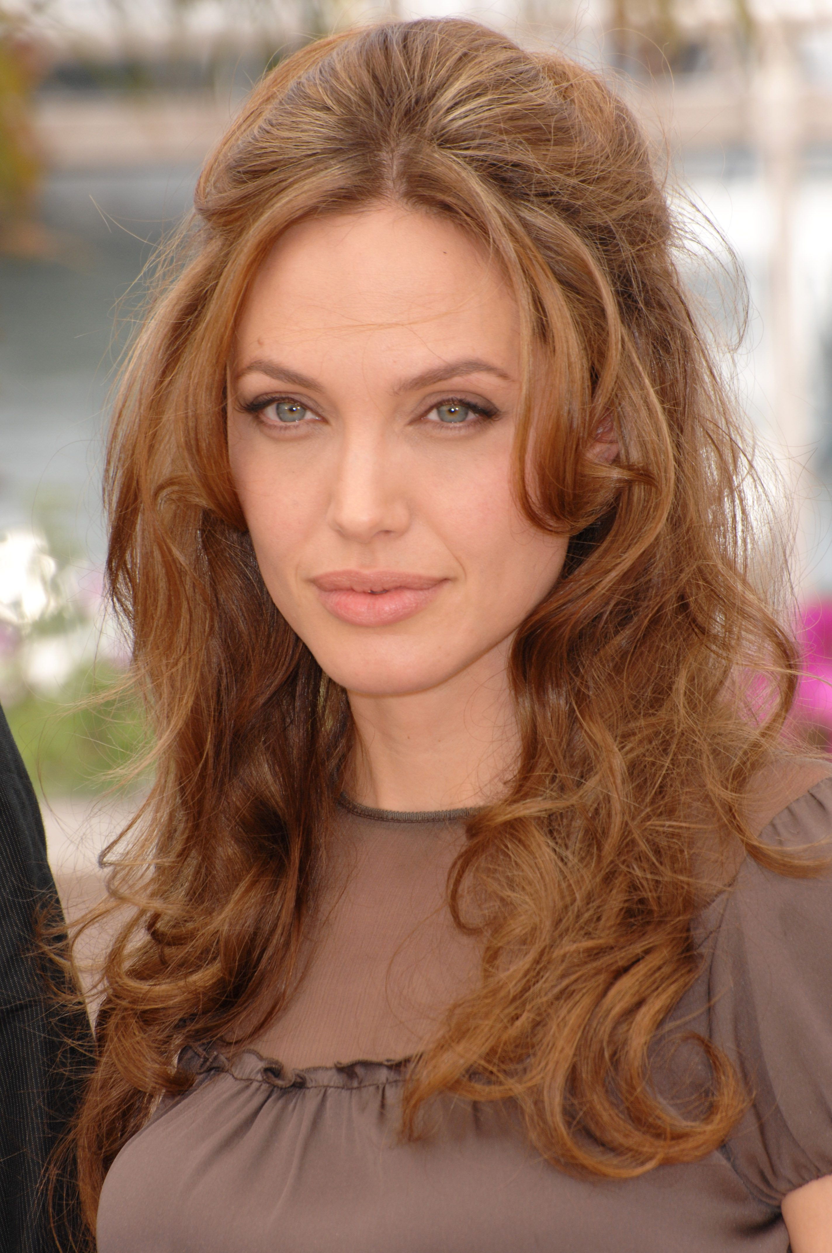 Angelina Jolie's Loose Curls with Puffy Top