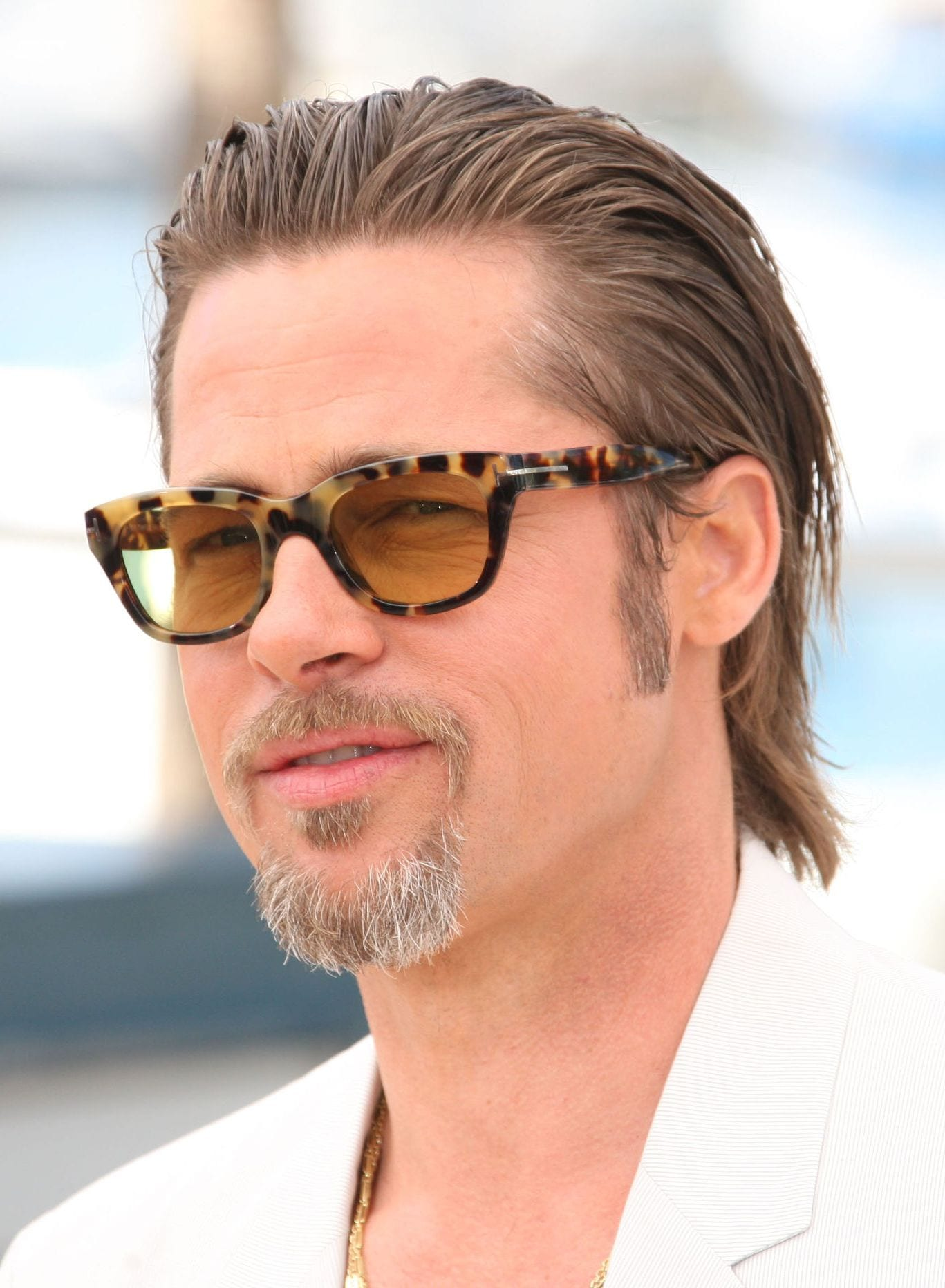 Brad Pitt medium slicked back hairstyle