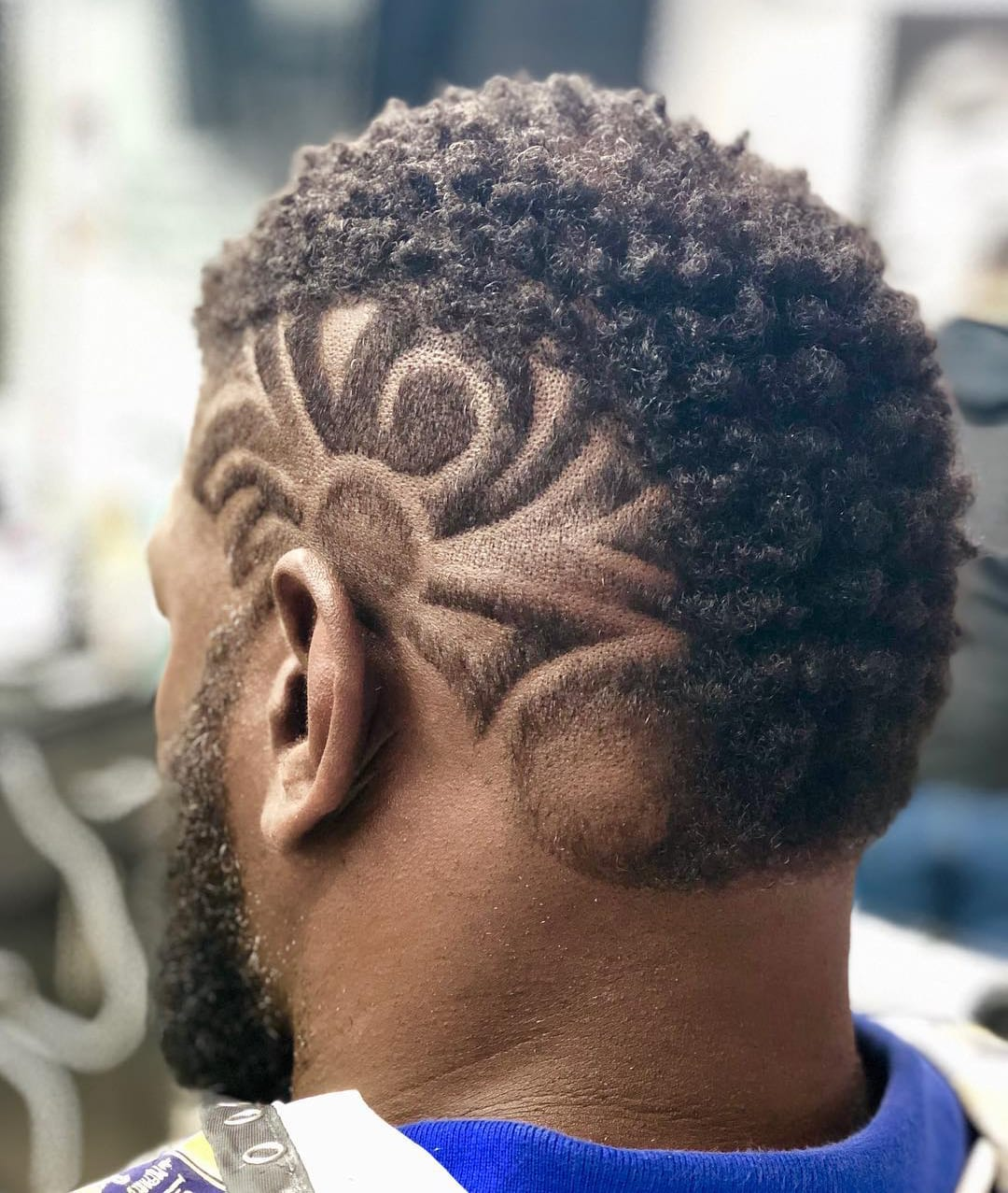 Curly Thick Mohawk and Side Lines Design_
