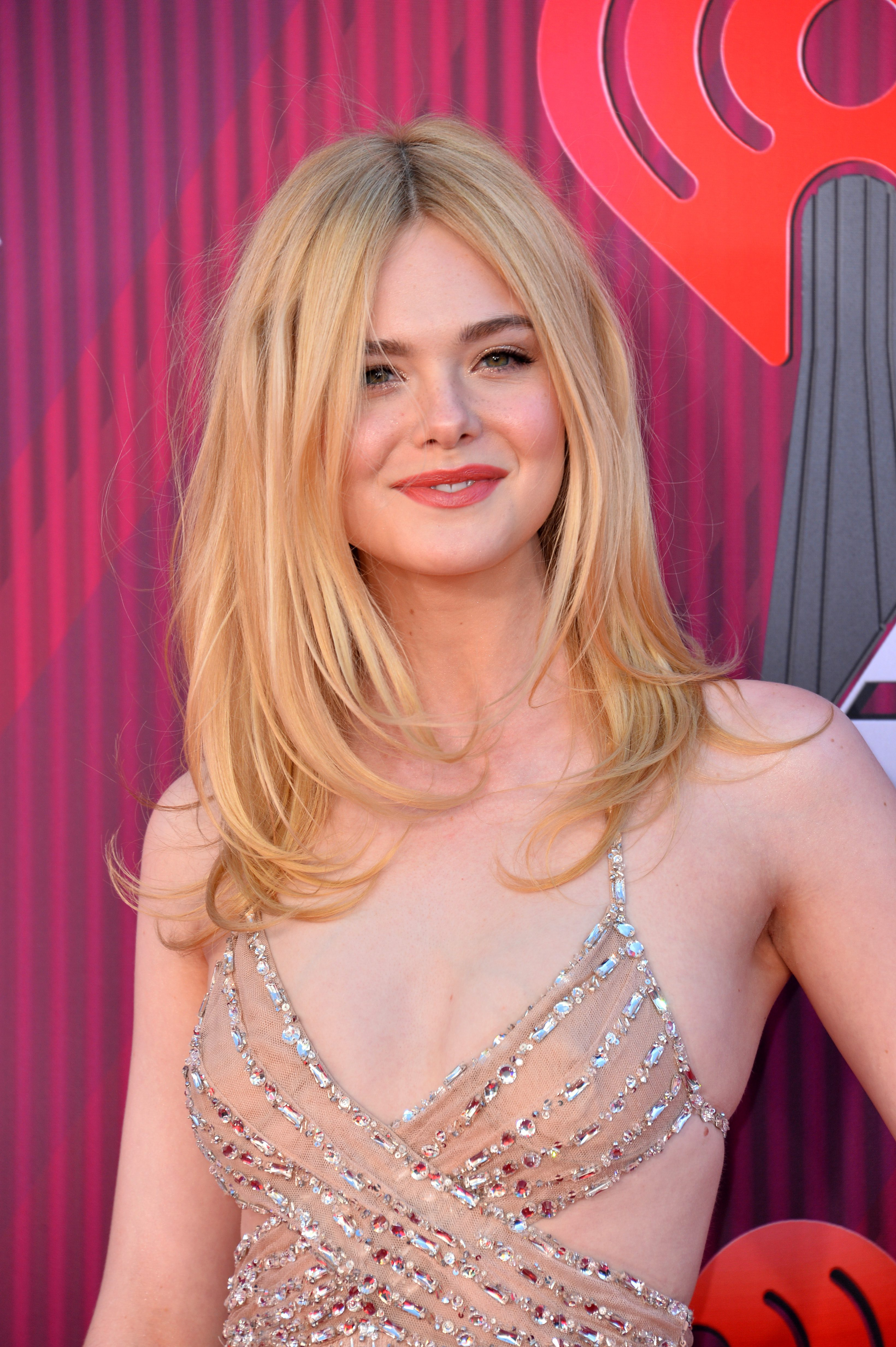 Elle Fanning's Bouncy Center-Parted Layers
