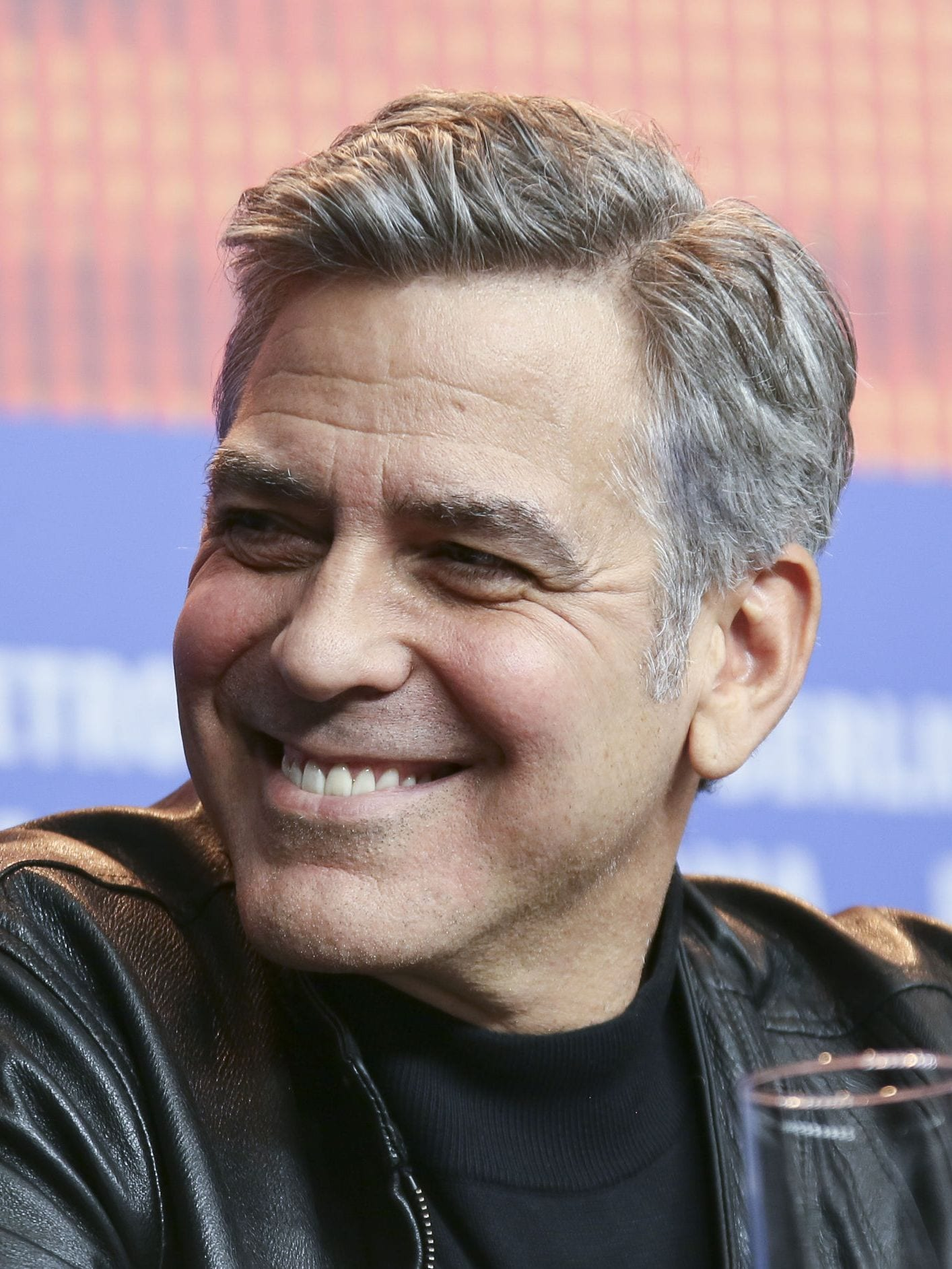 George Clooney side part hairstyle with grey hair