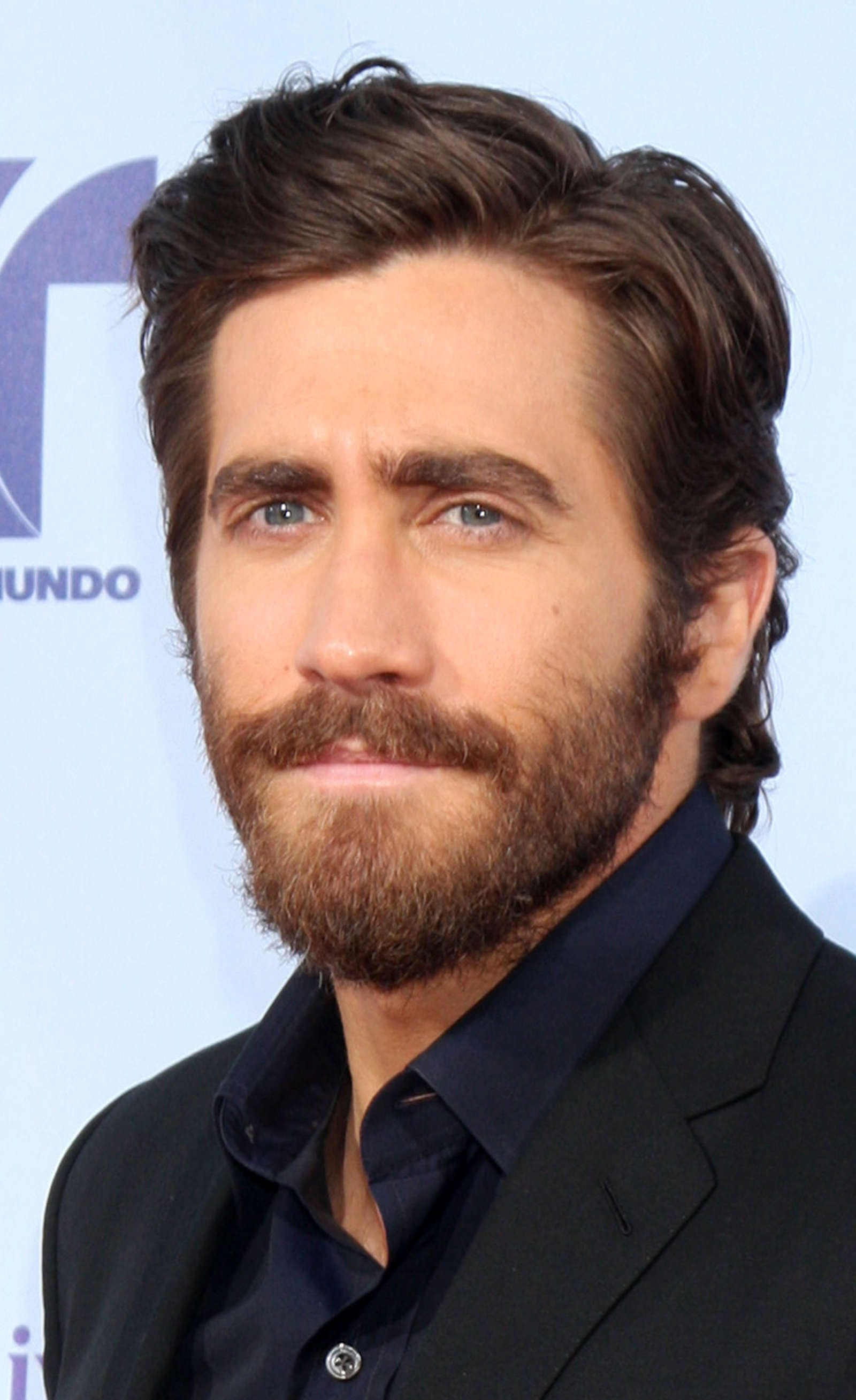 Jake Gyllenhaal side part long hair