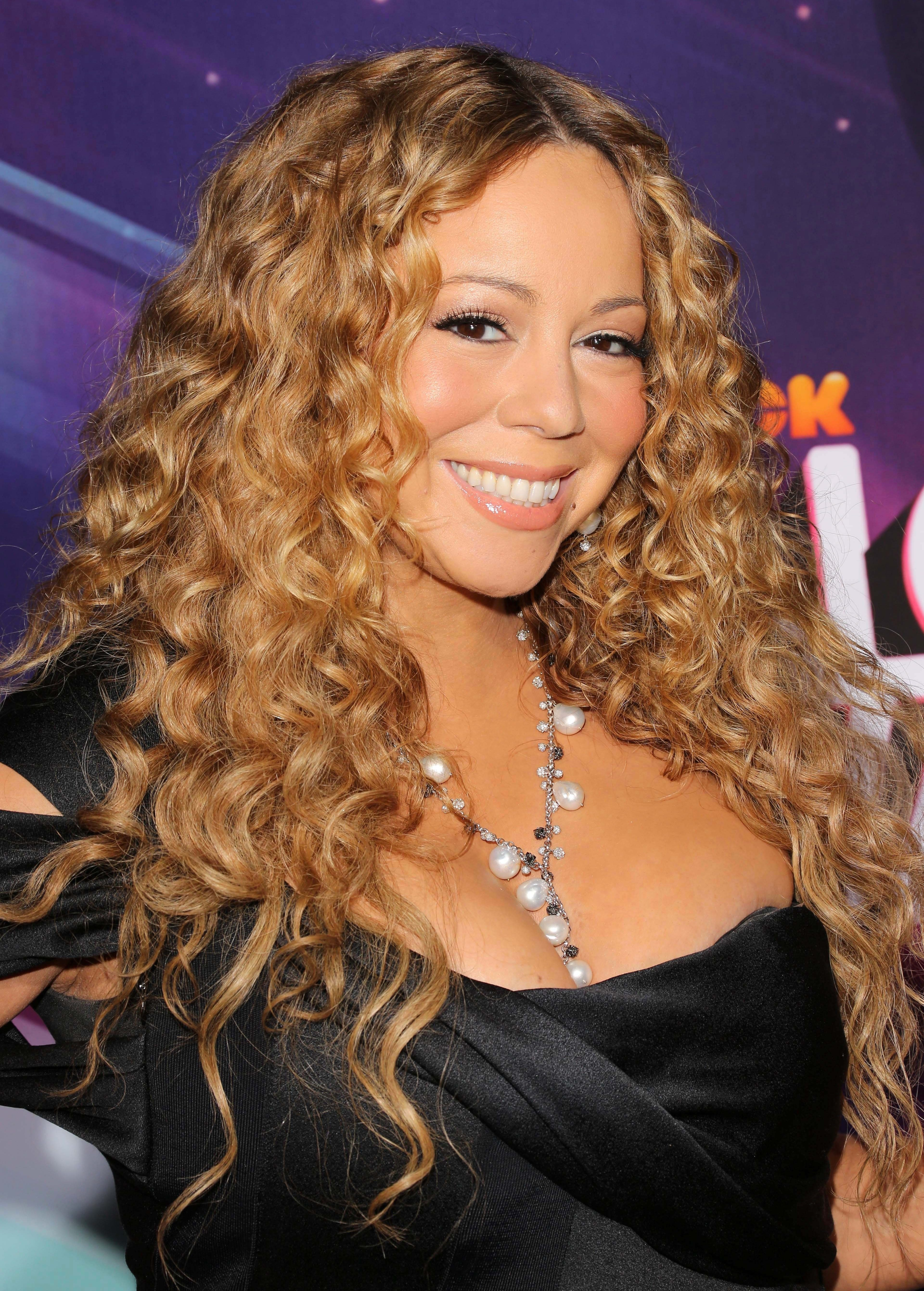 Mariah's Long Curled Hair Parted in the Middle