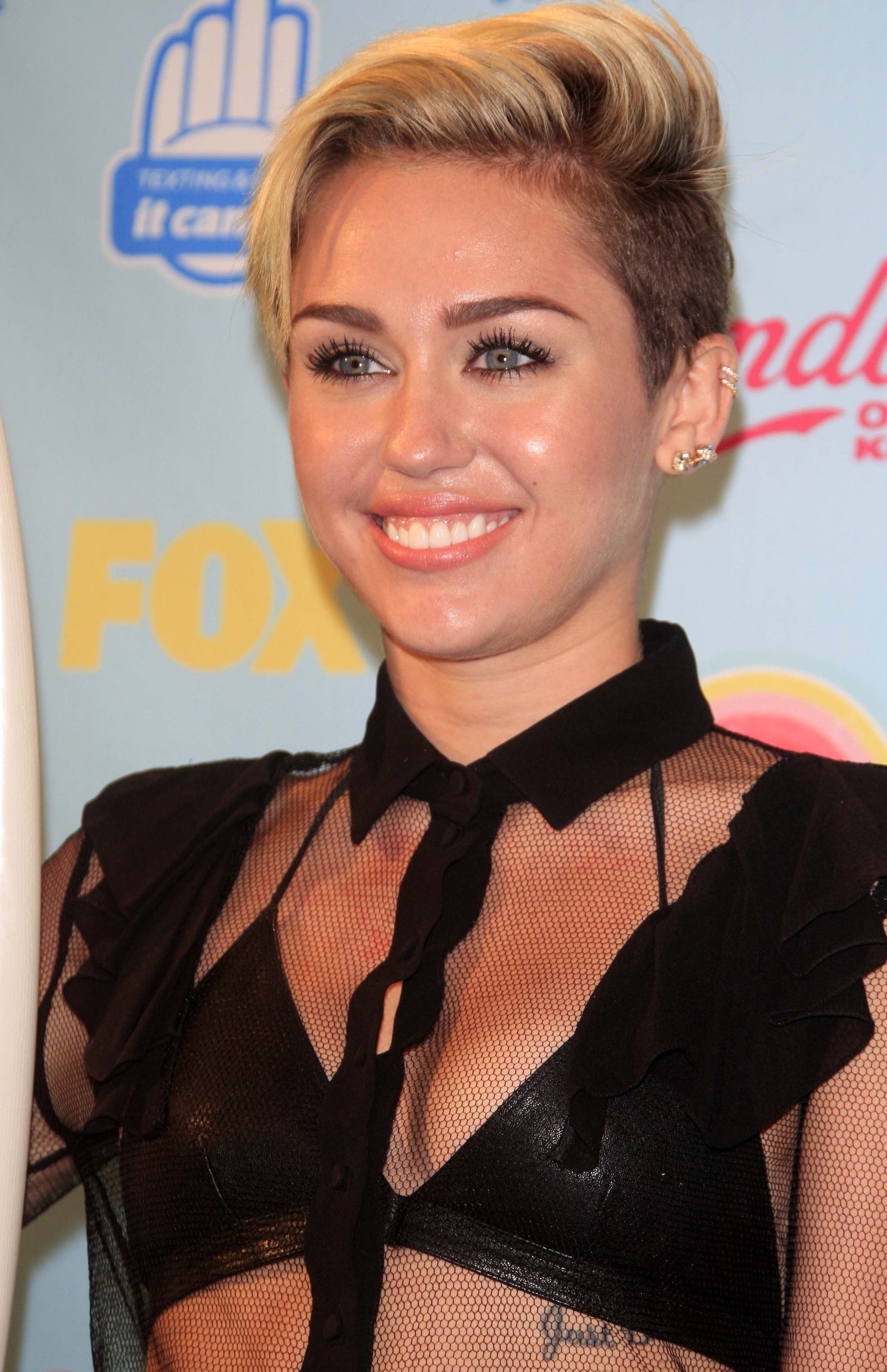 Miley Cyrus with her Blonde Side Parted Undercut