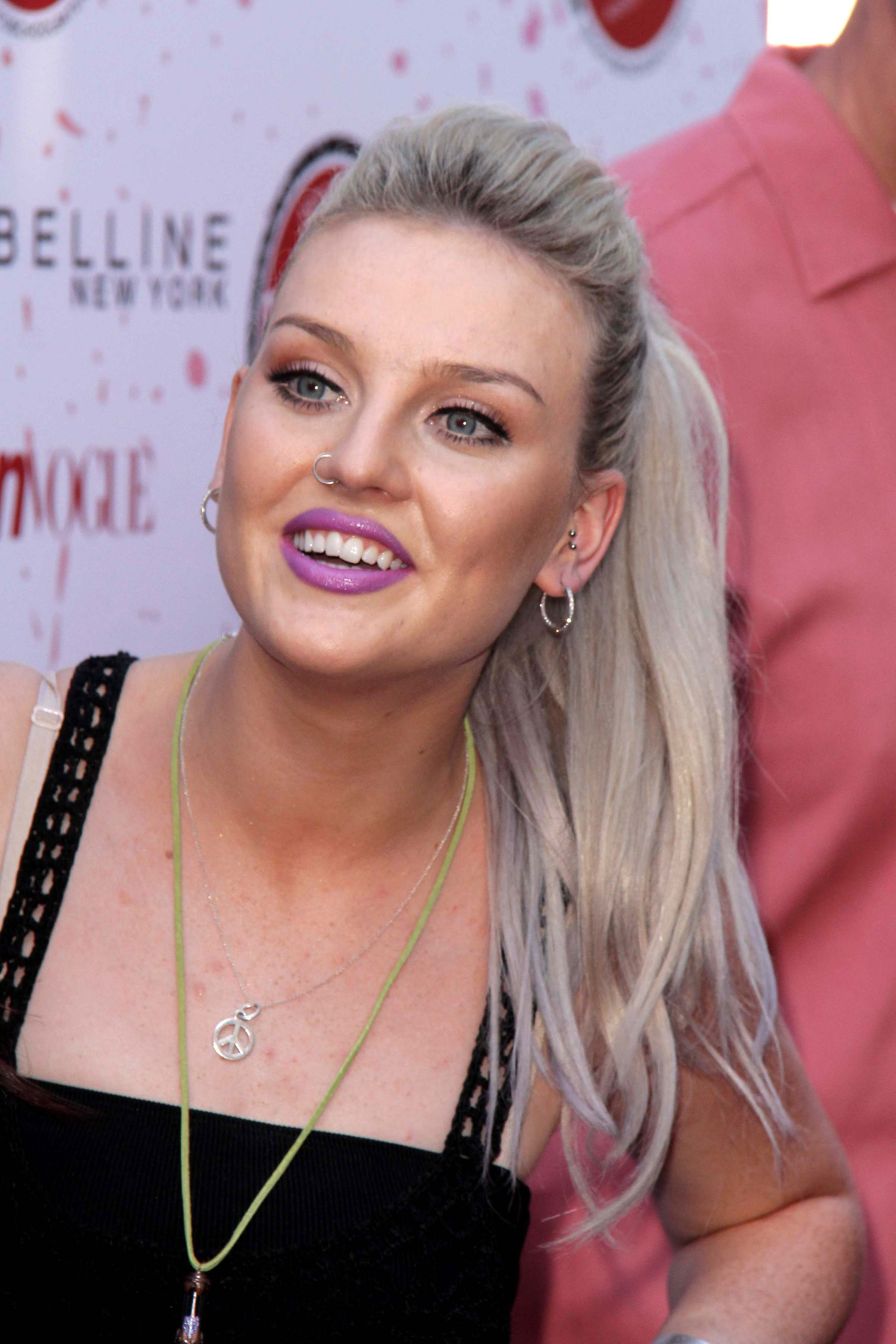 Perrie Edwards' Ash Blonde Hair with Subtle Purple Highlights