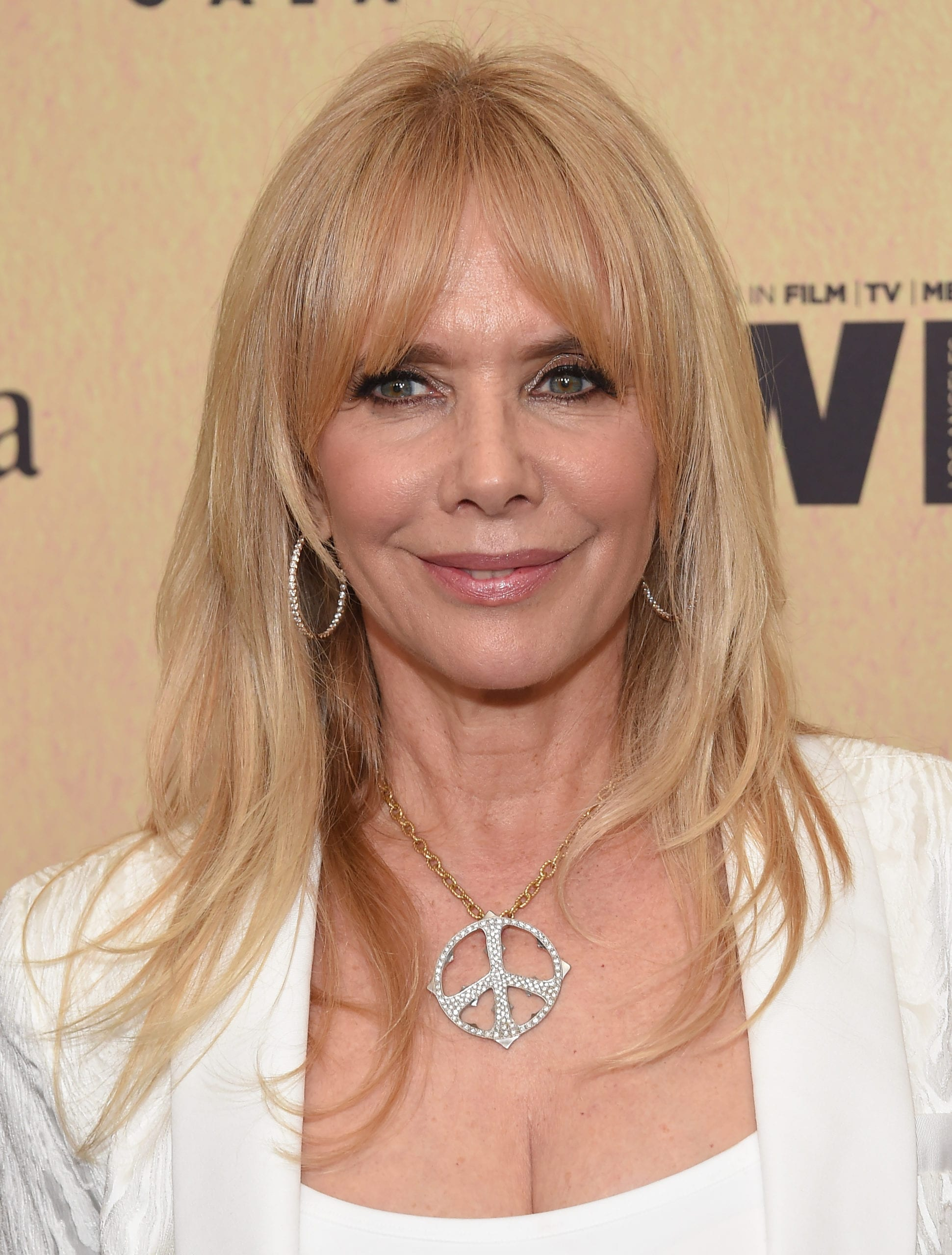 Rosanna Arquette's Curtain Bangs and Long Layers