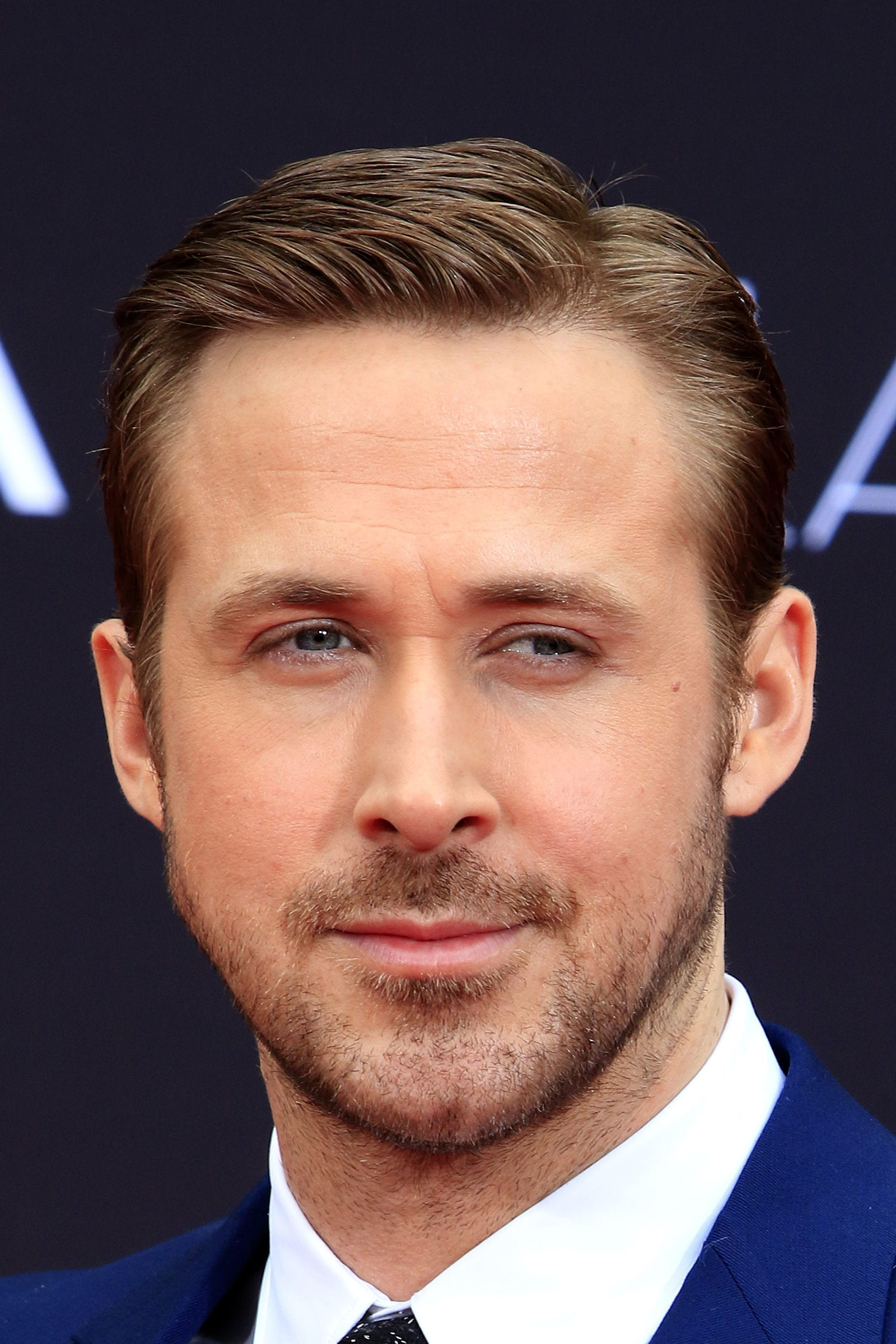 Ryan Gosling with a classic side part hairstyle
