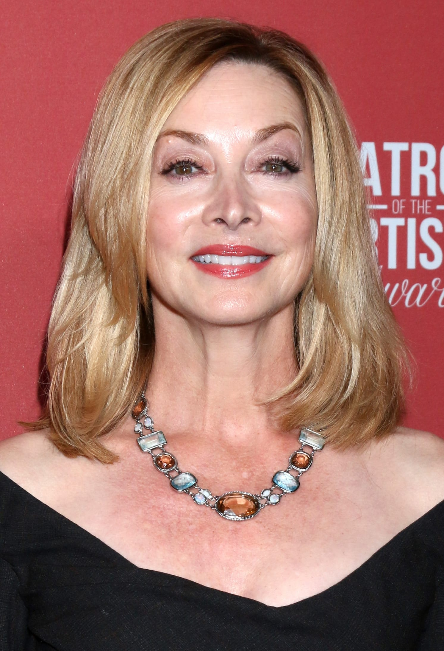 Sharon Lawrence's Medium Blonde Hair