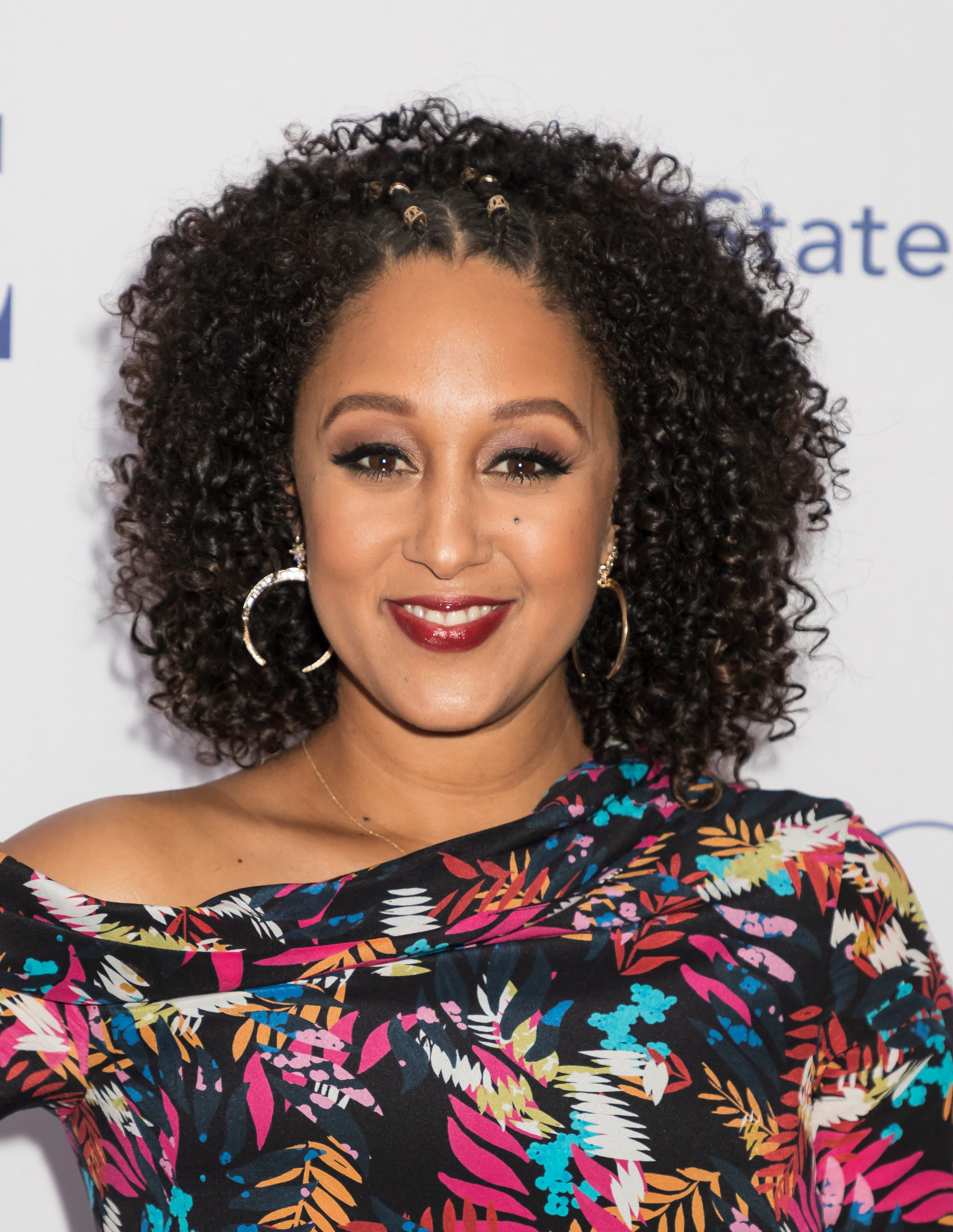 Tamera Mowry's Two Top Cornrows with Curls