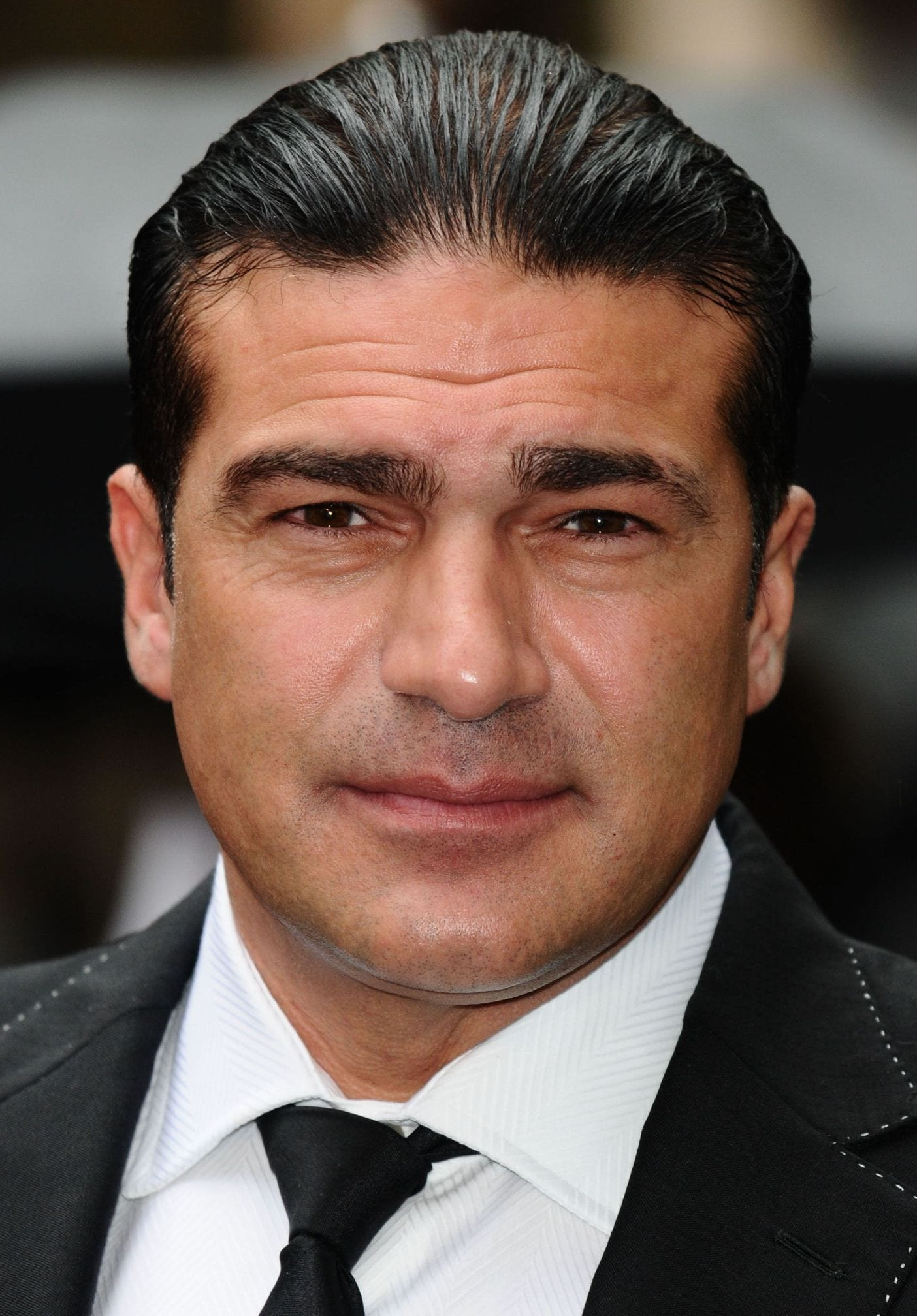Tammer Hassan slicked back