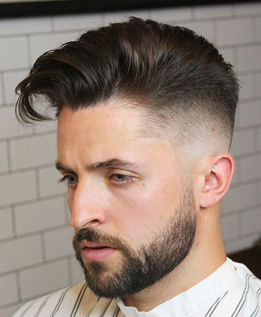 Taper fade, short beard, side swept