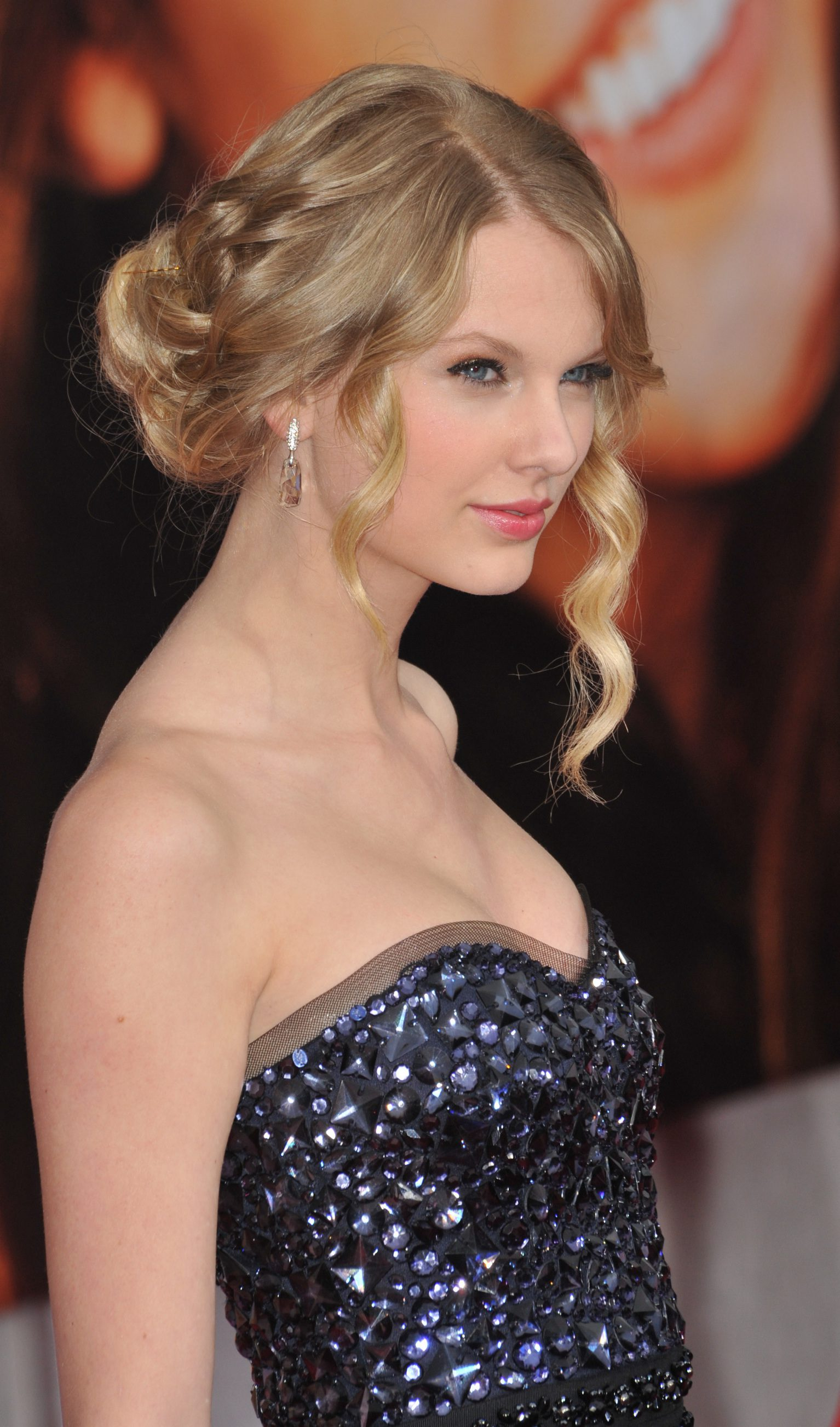 Taylor Swift Braiding it and Fringing that Updo