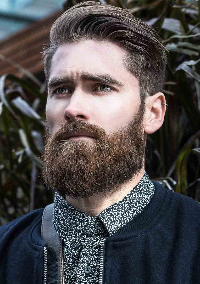 Thick beard, side swept, tapered undercut