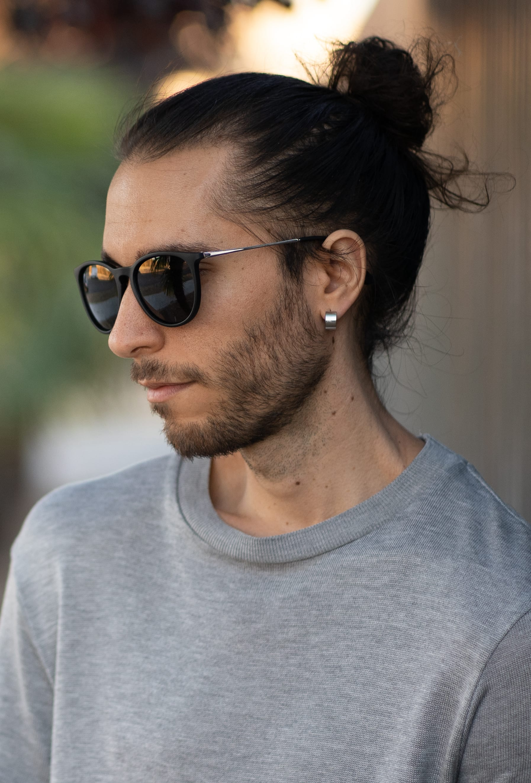 Thin Haired Man Bun with Stubble Sprinkle