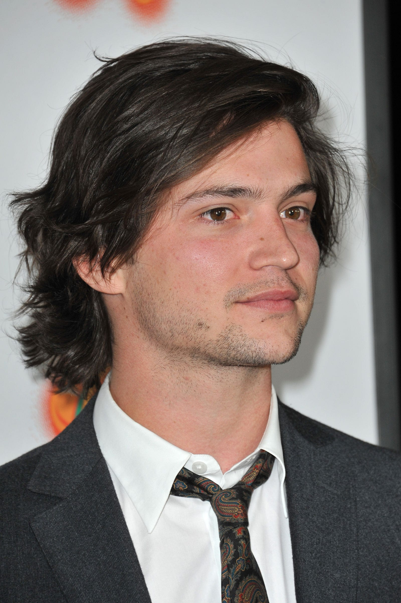 Thomas McDonell long hair surfer flow bro