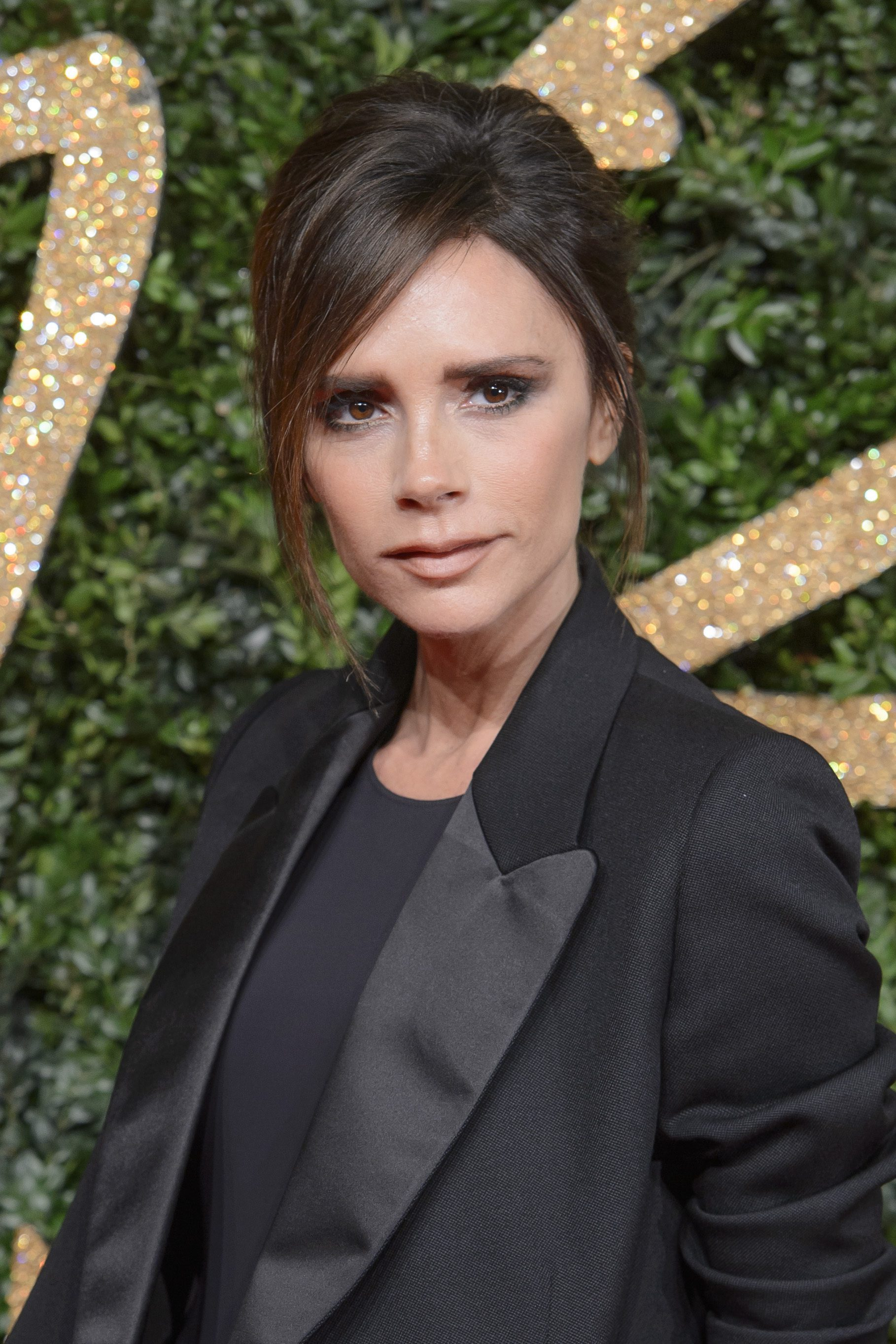 Victoria Beckham's Retro Updo With Side Bangs