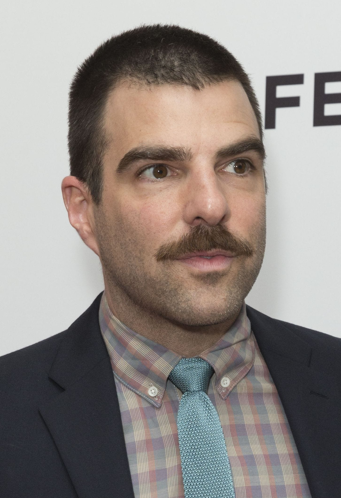 Zachary Quinto short buzz cut with mustache
