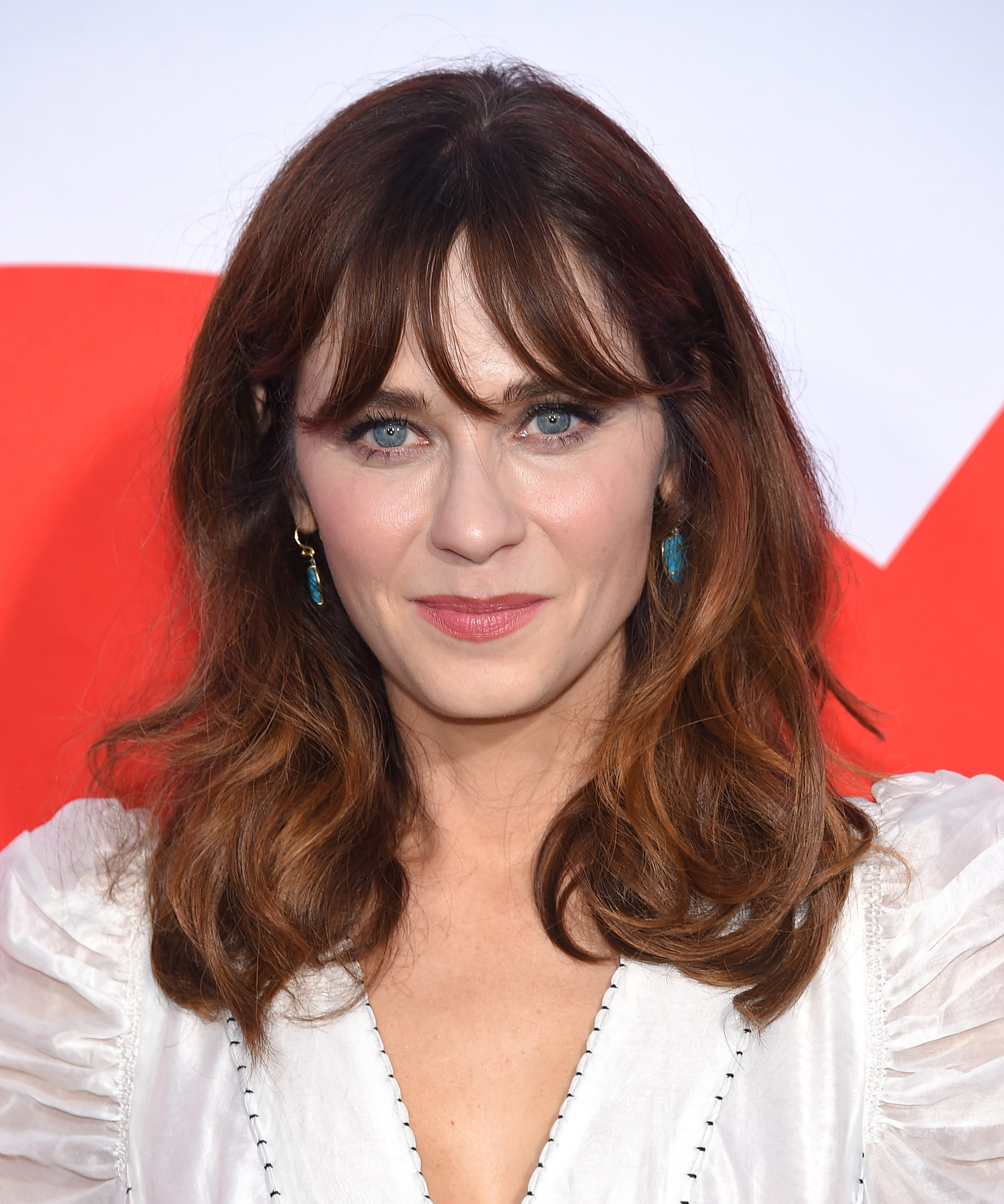 Zooey Deschanel's Chocolate Brown Hair with Red Balayage